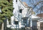 Foreclosed Home en W 106TH PL, Chicago, IL - 60628