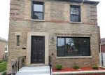 Foreclosed Home en S WOODLAWN AVE, Chicago, IL - 60628
