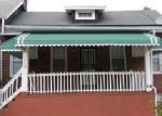 Foreclosed Home en POPLAR TER, Baltimore, MD - 21216