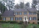 Foreclosed Home en COLONIAL DR SW, Lilburn, GA - 30047