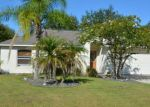 Foreclosed Home en LANGDON DR, Palm Coast, FL - 32137