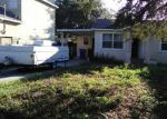 Foreclosed Home en LITTLE RIVER DR, Tampa, FL - 33615