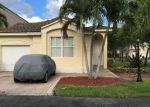 Foreclosed Home en NW 107TH PSGE, Miami, FL - 33178