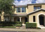 Foreclosed Home en SILENT CREEK DR, Tampa, FL - 33615
