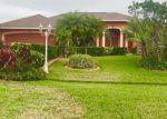 Foreclosed Home en SW PAAR DR, Port Saint Lucie, FL - 34953
