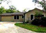 Foreclosed Home en OJEMAN RD, Houston, TX - 77080
