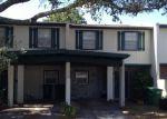 Foreclosed Home en TENNIS COURT CIR, Tampa, FL - 33617