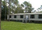 Foreclosed Home en BOGART DR, North Fort Myers, FL - 33917