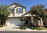 Foreclosed Home en W PEACH TREE LN, Fresno, CA - 93722