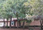 Foreclosed Home in N BUSH AVE, Denison, TX - 75020