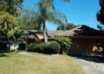 Foreclosed Home en GRAINARY AVE, Tampa, FL - 33624
