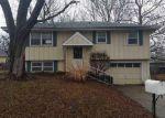 Foreclosed Home en N KING AVE, Harrisonville, MO - 64701