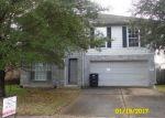 Foreclosed Home en W RIDGECREEK DR, Missouri City, TX - 77489