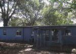Foreclosed Home en AVONWOOD CT, Orlando, FL - 32810