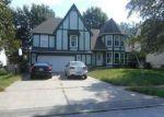 Foreclosed Home in S BLACKFOOT DR, Olathe, KS - 66062
