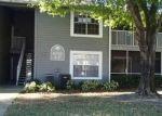 Foreclosed Home en LAKETREE LN, Tampa, FL - 33617