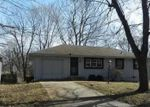 Foreclosed Home en PARKER AVE, Grandview, MO - 64030
