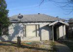 Foreclosed Home en W DENNETT AVE, Fresno, CA - 93728