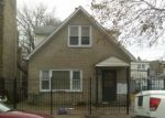 Foreclosed Home en W PARKER AVE, Chicago, IL - 60639