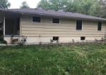 Foreclosed Home en ROBERTS ST, Kansas City, MO - 64124