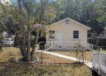 Foreclosed Home en W COMANCHE AVE, Tampa, FL - 33614