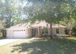 Foreclosed Home en PATRIC DR, Palm Coast, FL - 32164