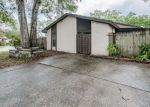 Foreclosed Home en PENNYTREE PL, Tampa, FL - 33624
