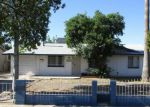 Foreclosed Home en W OSBORN RD, Phoenix, AZ - 85033