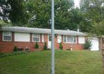 Foreclosed Home en NE 82ND TER, Kansas City, MO - 64118
