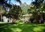 Foreclosed Home en FARRADAY LN, Palm Coast, FL - 32137