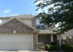 Foreclosed Home en MARCELIA DR, Houston, TX - 77049