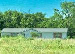 Foreclosed Home in REDWOOD LN, Lacygne, KS - 66040