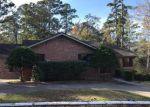 Foreclosed Home en S ROYALE GREENS DR, Coldspring, TX - 77331
