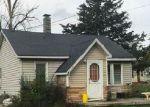 Foreclosed Home en GREENLY ST, Burton, MI - 48529