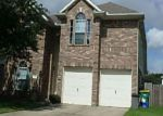 Foreclosed Home in E LINDBERGH CT, Baytown, TX - 77521