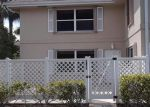Foreclosed Home en SW SUNSET TRACE CIR, Palm City, FL - 34990