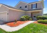 Foreclosed Home in TORI LN, Jacksonville, FL - 32218