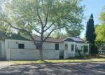 Foreclosed Home en E LYELL AVE, Fresno, CA - 93702
