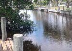 Foreclosed Home en ESTATE DR, North Fort Myers, FL - 33917