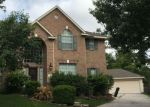 Foreclosed Home in SUNSET MAPLE CT, Kingwood, TX - 77345