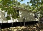 Foreclosed Home en SE 51ST LN, Center Hill, FL - 33514