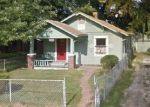 Foreclosed Home en SPRUCE AVE, Kansas City, MO - 64128