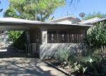 Foreclosed Home en LA VEGA DR SW, Albuquerque, NM - 87105