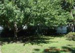 Foreclosed Home en ASH AVE, Kansas City, MO - 64133