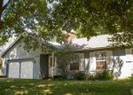 Foreclosed Home in KEMBLE DR, Oskaloosa, IA - 52577