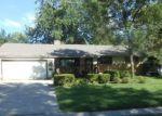 Foreclosed Home en ELM AVE, Kansas City, MO - 64138