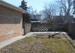 Foreclosed Home en COUNTRY CLUB DR, Melrose Park, IL - 60164