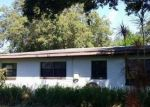 Foreclosed Home in W OAKELLAR AVE, Tampa, FL - 33611
