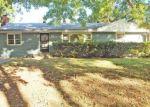 Foreclosed Home en SYCAMORE AVE, Kansas City, MO - 64129