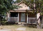 Foreclosed Home in W 10TH ST, Coffeyville, KS - 67337